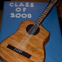 Guitar Graduation Cake CSM: Guitar cake covered in Satin Ic. The neck portion was made out of foam core and covered in Satin Ice