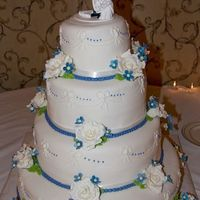 Blue And White Wedding CSM: This was my first all cake wedding cake, and even though I had some issues with it I am still happy with the end result. It was a 4...