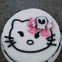 Hello Kitty This was a request from my niece who likes the angry goth Hello Kitty version. It is a fondant cake with zebra stripes. I cut the Hello...