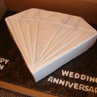 60Th Anniversary Diamond This was carved from a thick sheet cake. I made a pattern using paper and folded it to get the pattern I wanted. The cake is iced in...