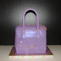 Purple Prada Yellow cake with strawberry filling covered in fondant with fondant/gumpaste details
