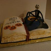 Jack Skellington Open Book Cake The cake was carved from a thick sheet cake and iced in buttercream with rice paper pages on top with fondant details. Side pages...