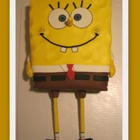 Spongebob In Buttercream 9x12 cut down to size. Body (yellow) is BC. Pants & shirt are fondant. Arms & legs are GP. Legs have a dowel in them. Fun to make...