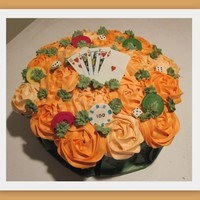 Cupcake Bouquet Game Night!   19 regular sized cupcakes. Flowers are done with tip 1M. Cards are GP with an edible image. Dice are GP. Chips are candy clay.