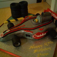 Formula 1 Race Car was asked to make this for a friend, man i hate doing cars when will i ever be any good at them? lol. cake is plain sponge with gumpaste...