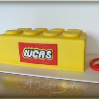 Yellow Lego wasc covered in MMF. Pegs on top are mmf cuttouts. Logo made on paint and then handcut from 50/50
