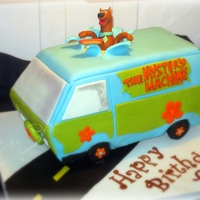 Scooby Doo Mystery Machine WASC cake with Indy's BC for filling. Covered in White ganache, then MMF. Scooby Made with MMF and Gumpaste. Tires are cereal treats...