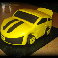 Yellow Race Car Vanilla wasc cake. Yellow MMF. RKT tires.