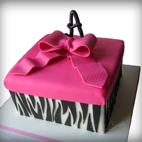 "Present Cake Vanilla cake with Chocolate filling. 8"" square with MMF. Black Satin Ice for zebra strips. 50/50 mix for bow."
