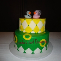 Mo's Oregon Ducks The groom's favorite team is the Oregon Ducks. The cake is chocolate iced with butter cream and fondant accents and duck wedding...