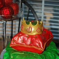 Christmas Prince First Birthday A 10 inch round with the smallest pillow pan and 4 inch round (for the crown) on top. Fondant/gumpaste mix for the blanket the pillow is...