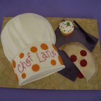 Chef Hat With Calzone And Cupcake This cake was done to match party invitations, and to incorporate the elements of a make-and-bake themed party. The guests were making...