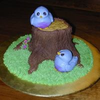 Bluebirds On A Tree Stump Sorry for the dark picture... Lemon cake bluebirds are sculpted and covered in buttercream. Tree stump is also buttercream. Royal icing...