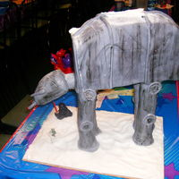 At At Walker Star wars cake for my sons 8th Birthday. PVC and RKT legs, RKT head and chocolate cake and chocolate ganache body all covered in fondant....