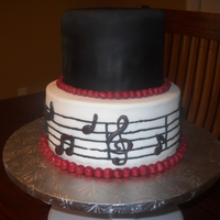 Twins 18Th Birthday Music Theme Cake top tier- cocolate cake with cherry swiss meringue buttercream. botton tier- red velvet with cream cheese filling. black and white fondant...