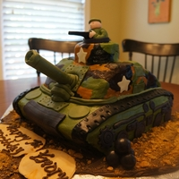 Army Tank   Made this for my son's 7th birthday, army party. Carved from two 13x9s and a 10x10. All buttercream with fondant accents.
