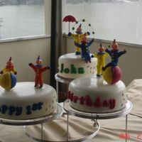 Clown Cake This cake was done for a boy's 1st b-day. Clowns are made out of royal icing, cake covered in fondant, fondant sprinkles and lettering...