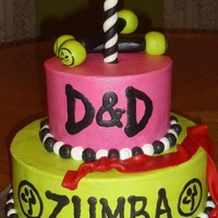 Zumba made for our zumba instructors' one year zumba celebration. buttercream with fondant candle, toning sticks, and stretch band