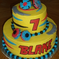 Beyblade inspired by many beyblade cakes on CC! buttercream with fondant beyblades and swirls