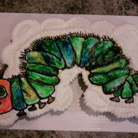Hungry Caterpillar Cupcake Cake White and Chocolate Cupcakes with Hungry Caterpillar Buttercream Transfer handpainted with gel food coloring