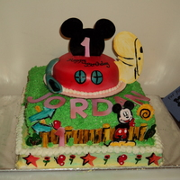 "Mickey Mouse Clubhouse White Cake, Buttercream Icing....Fondant/Gumpaste accents. Designed so Clubhouse can be removed to be used as ""smash cake"" for..."