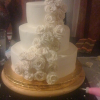 Cascading Roses Wedding Cake   The bride wanted a simple white/ivory cake with cascading roses. All buttercream.
