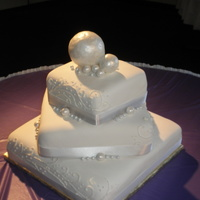 Pearl Wedding Cake  All fondant. 16, 12 and 9 inches. The two biggest pearls were fondant covered styrofoam balls painted with pearl dust. The medium pearls...