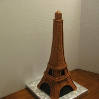 Eiffel Tower   Buttermilk Base Cake covered in modeling Chocolate.I made this in a class with the amazing Mike McCarey.