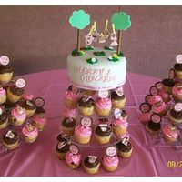 Clothesline Baby Shower Cake And Cupcakes   Cake covered in MMF, all other decorations are fondant.