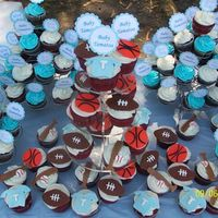 Sports Theme Baby Shower Cupcakes Sports theme baby shower cupcakes and cupcake picks made with Cricut.