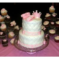 Princess Baby Shower Cake 6 inch and 8 inch cake, covered in MMF, diamond pattern, ediblie balls topped with fondant sandals and crown, and cupcakes with fondant...