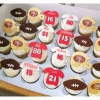 Sf 49Er Cupcakes  Helmet, football, and jerseys were cut with fondant. Helmet painted with gold dust and edible image of 49er logo. Number cut with fondant,...