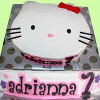Hello Kitty! for a 7th birthday cake, covered in buttercream and fondant accents. cupcakes have fondant designs