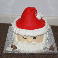 "Santa Clause Face/head Santa Clause face/head is an 8"" red velvet cake and rice krispies for the hat peak covered in fondant (hat only). all the rest is in..."