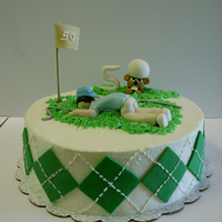 Golf Bd Cake Son's bd cake, pina colada cake with imbc frosting. GP decorations. The gopher was inspired by a cake on cc-sorry don't remember...