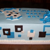 Baby Boy I got this idea from another CC'er. Chocolate fudge cake with buttercream and fondant accents.