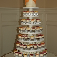 Cupcake Wedding Tower   Red Velvet cupcakes with cream cheese icing. Cake is also Red Velvet with gumpaste bow
