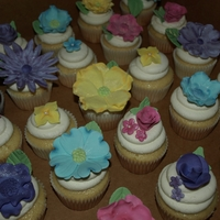 Flower Cupcakes Fantasy Flower cupcakes made to match colors for a Bridal shower.