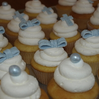 Cupcakes   cupcakes made for a baptism, with pearls, corsses, and bows on top of each