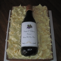 Wine Bottle The box of this cake was 2 9x13 cakes stacked with fondant sides. The wine bottle was made out of fondant with a paper label since the...