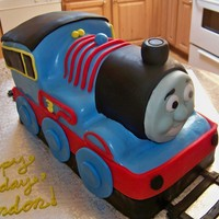 A Train Cake That Looks Similar To The Licensed Character Thomas The Train! Thomas is licensed so meet Tim the Train!! Carved cake, MMF details and gumpaste face. Thanks for looking!