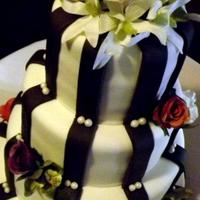 Modern Striped Wedding Cake Cake covered with MMF, flowers are fake. Thanks for looking!