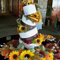 Topsy Turvy Wedding Cake I used Cake Stackers Topsy base and got THIS sweet gem! I love this cake so much! Cake covered with MMF, The flowers and ribbon are fake by...