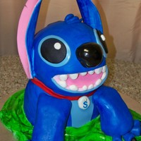 Blue Alien That Sort Of Resembles The Licensed Character Stitch Cake Stitch is licensed so everyone...meet Stotch! Ears are gumpaste and everything else is MMF. Thanks for looking!