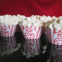 Popcorn Box Cupcake regular cupcake, buttercream icing, topped with mini marshmallows, printed a wrapper from computer and secured with doublestick tape. Would...
