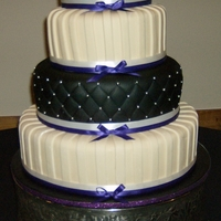 Black And Ivory Wedding Cake Black fondant with diamond quilting and dragees. (Thanks for Jen Dontz' diamond quilter!) Ivory fondant strips. Ivory tiers are French...