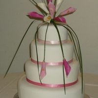 "Pink Calla Lily Cake Handmade gumpaste calla lilies on simple white cake. Graduated ribbon colors. Inspired by a cake in ""Wedding Cakes: A Design Source.&..."