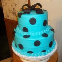 "Chocolate & Electric Blue Shower Cake 7"" & 10"" Cake with buttercream icing and fondant dots and bow for a baby shower."