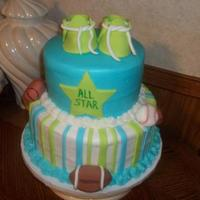 "Sports Baby 7"" and 10"" Chocolate cake with fondant decorations for a sports themed baby shower."