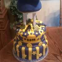 Grad Cake 10 in and 8 in stacked with 1/2 ball(used for cap base ) on tier. Fondant.